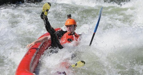 camper kayaking on the south fork of the american river and falling out