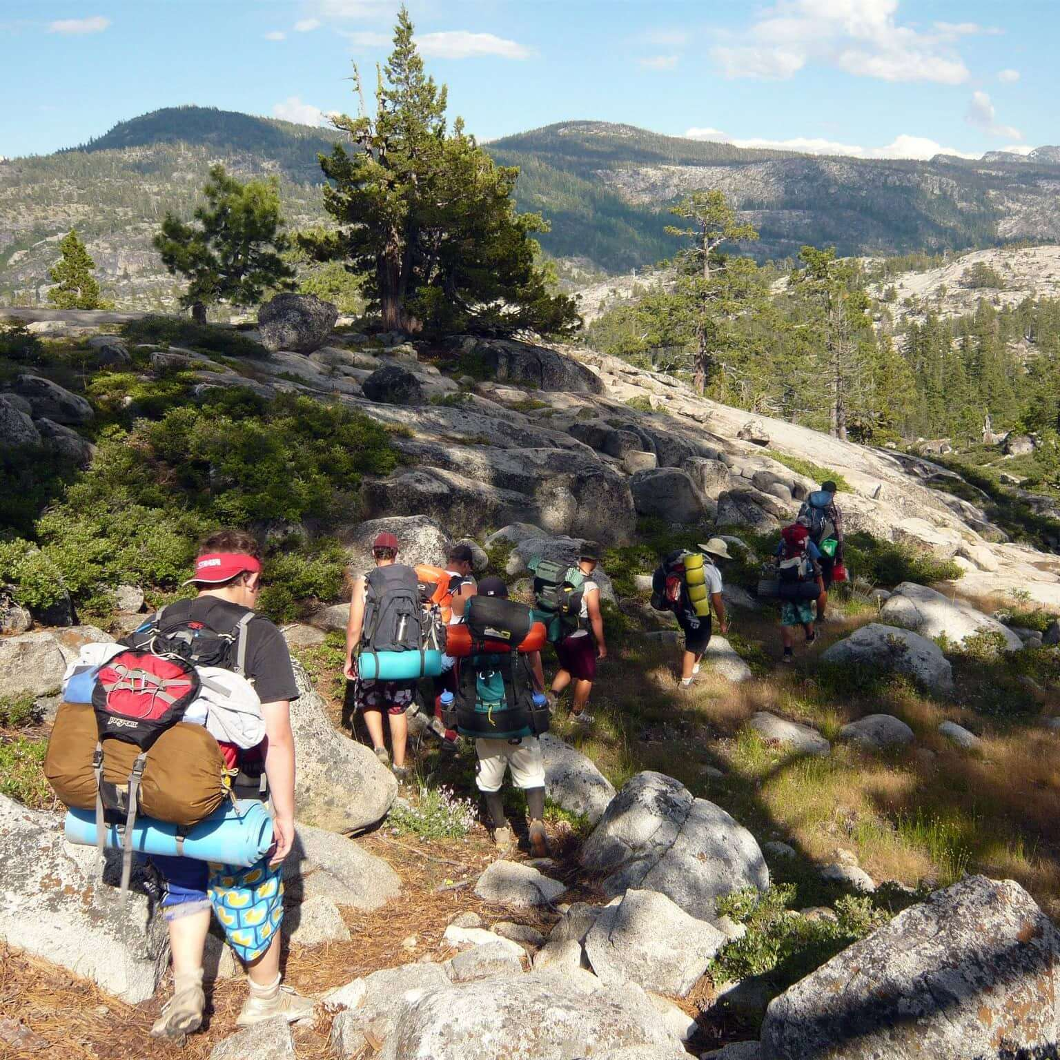hikers in backcountry with backpacks.
