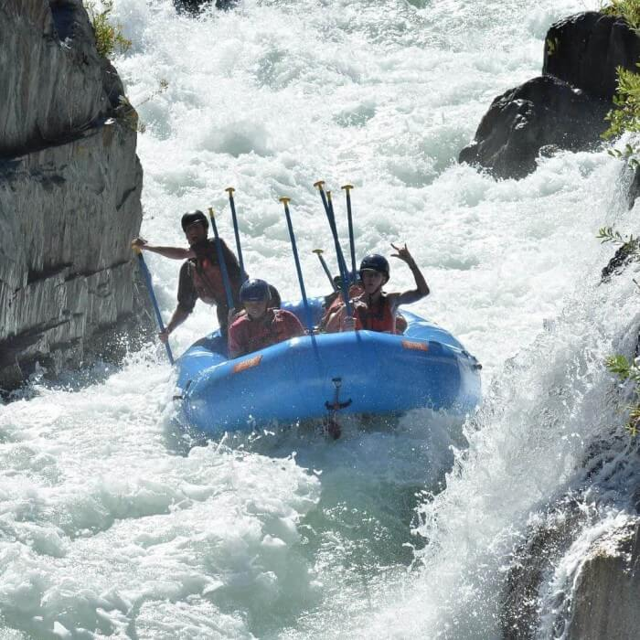 Raft in middle of huge class 4 whitewater rapid