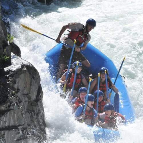 Whitewater raft finishing huge class 4 rapid tunnel chute middle fork