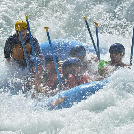 Whitewater raft in large class 4 rapid tunnel chute