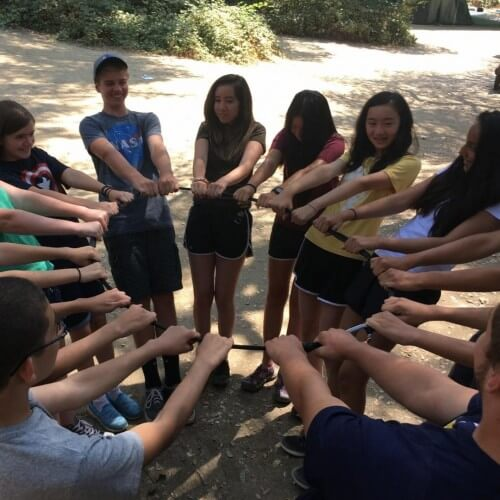 team building trust circle at camp
