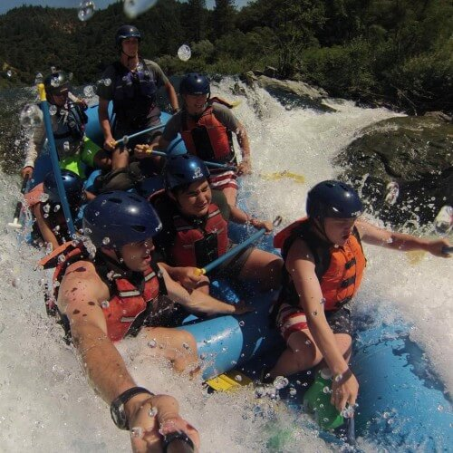 action camera close up of raft going through whitewater rapid