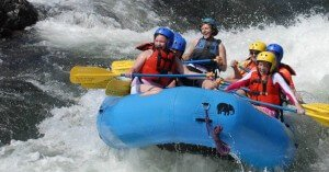 campers white water rafting in California