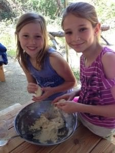 girls on a California field trip making flour tortillas