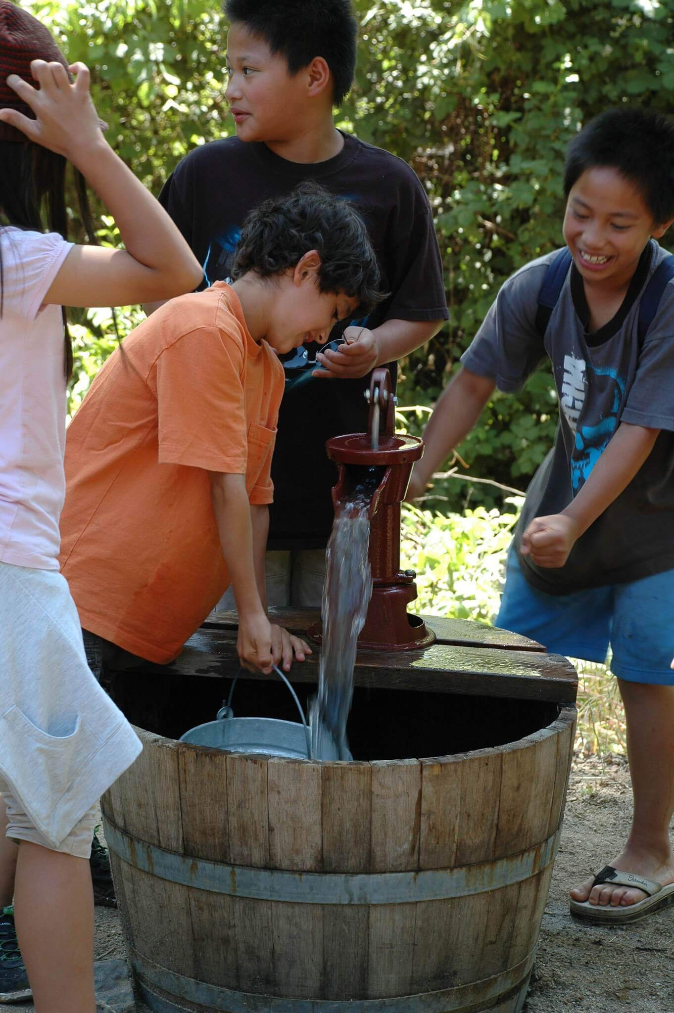pumping water from a mock well on a school field trip